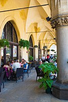 Cafe outside Sukiennice the Cloth Hall in Krakow Poland Europe