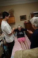 Photo essay. Home visit of a kinesitherapist to see a person affected by multiple sclerosis.