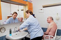 Independent nurse, in Vénissieux, France. Toilette of a patient presenting an alteration of mobility motor handicap following a cerebral vascular acci...
