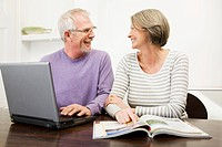 Mature man and woman using a laptop