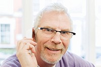 Mature man using telephone (thumbnail)