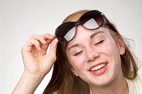 18 year old girl with sunglasses in studio portrait