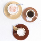 Cups with coffee, cappuccino and espresso _ top view