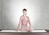 Woman doing yoga exercise (thumbnail)