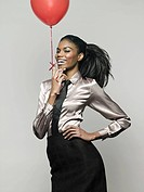 Businesswoman holding balloon