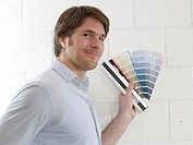 Man with colour palettes (thumbnail)