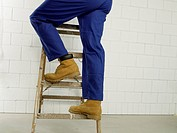Man on a ladder, lower body
