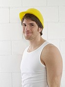 Man wearing helmet and undershirt