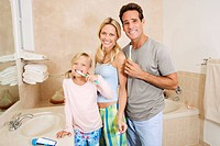 Family brushing teeth in the bathroom