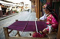 A woman kniting in a Sangri La street, Yunan province