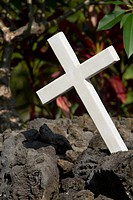 Close_up of a cross on a grave