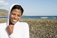 Smiling woman on a shingle beach