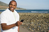 Man using a cellular telephone on a beach