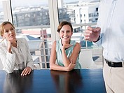 Smiling women in a meeting