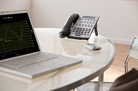 Laptop and telephone in office