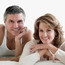 Couple lying on the bed and smiling