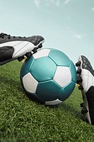 Close_up of a soccer ball and a pair of shoes