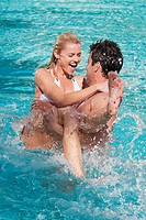 Couple having fun in a swimming pool, Biltmore Hotel, Coral Gables, Florida, USA