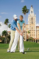 Couple playing golf, Biltmore Golf Course, Biltmore Hotel, Florida, USA