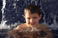 Portrait of a boy in a swimming pool
