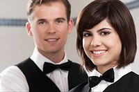 Portrait of two waiters in a restaurant