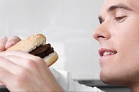 Close_up of a waiter holding a burger