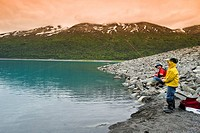 Father and son fishing at Eklutna Lake in Southcentral Alaska during Summer