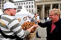 Street seller of pretzels in the Brandenburg Gate area, Berlin. Germany