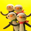 Toy penguins wearing scarves