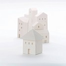 White model houses on white background