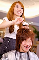 Hairdresser cutting customer´s hair, Hair Salon