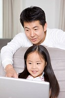 Family, father and daughter using laptop