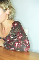 Blonde Woman sitting at a Table cropped