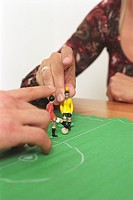 People playing with a Table Soccer Game Detail (thumbnail)