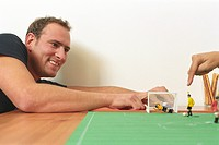 Man playing with a Table Soccer Game Detail