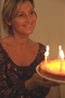 Woman holding a Birthday Cake half_portrait