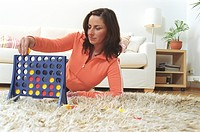 Woman playing a strategic Game