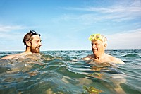 Portrait of two men swimming in sea