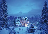 Schloss Kranzbach with Christmas tree at twilight, Werdenfels, Bavaria, Germany