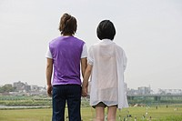 Rear view of couple holding hands (thumbnail)