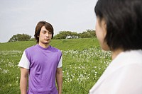 Young man and woman on a field