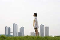 Young woman in front of city skyline