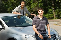 Two male friends with a car