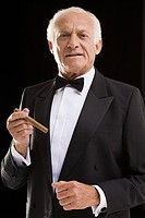Man in dinner jacket with cigar