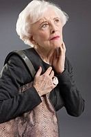 Senior woman with shoulder bag