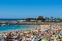 Tourists at Playa de Amadores, Puerto Rico, Grand Canary, Canary
