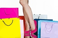 Legs of woman with shopping bags