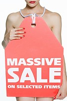 Woman with massive sale sign
