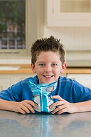 Boy with a packet of crisps