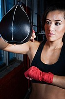 Female boxer using punch bag